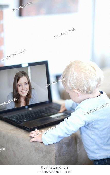 Baby boy distracted on video call to mother