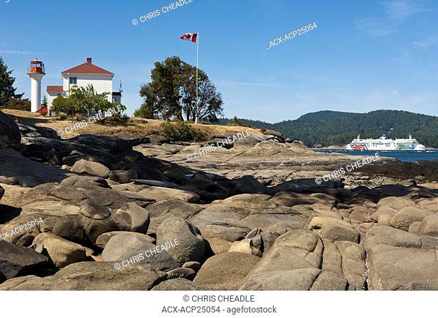 BC Ferry passes Georgina Point Lighthouse, Mayne Island, Gulf Islands, BC, Canada