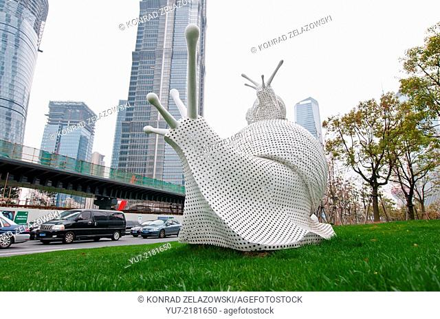 snail statues in Lujiazui Finance and Trade Zone in Pudong District, with Jin Mao Tower skyscraper on background - Shanghai, China