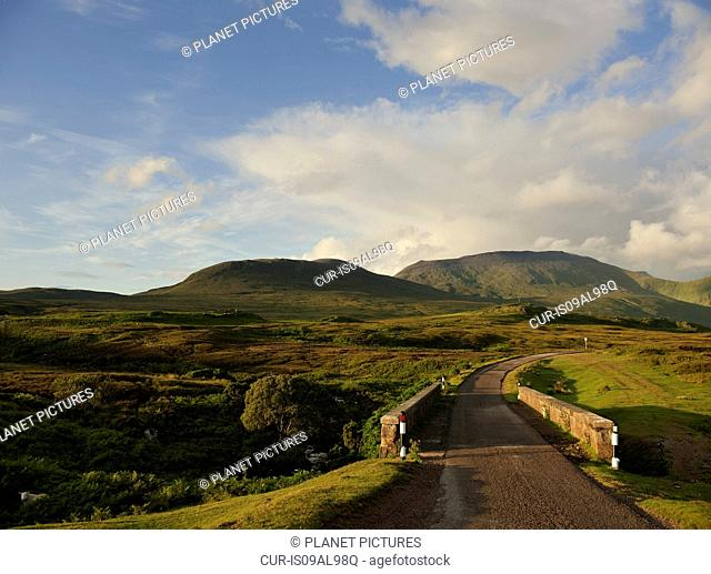 Rural road and distant mountains, Assynt, Scotland