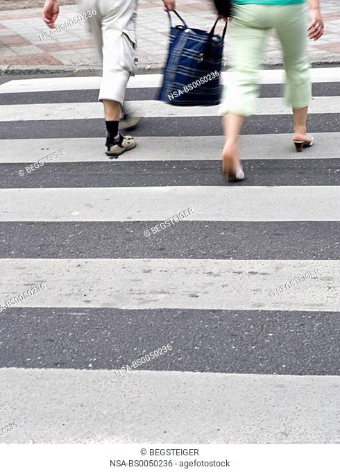 pedestrians crossing crosswalk