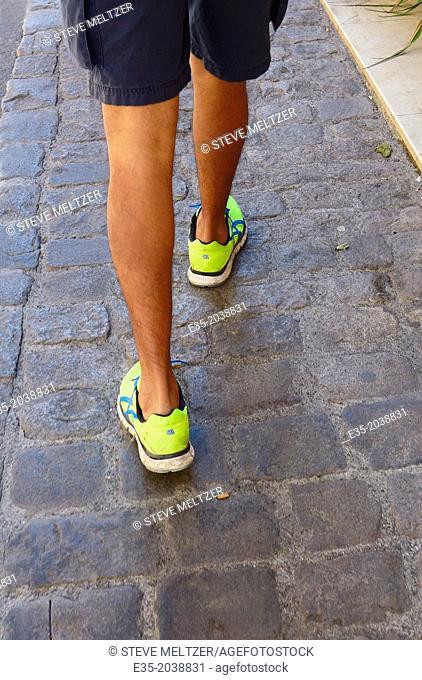 Walking in fluorescent green sneakers