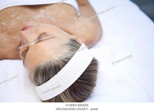 view from above of woman having salt scrub treatment