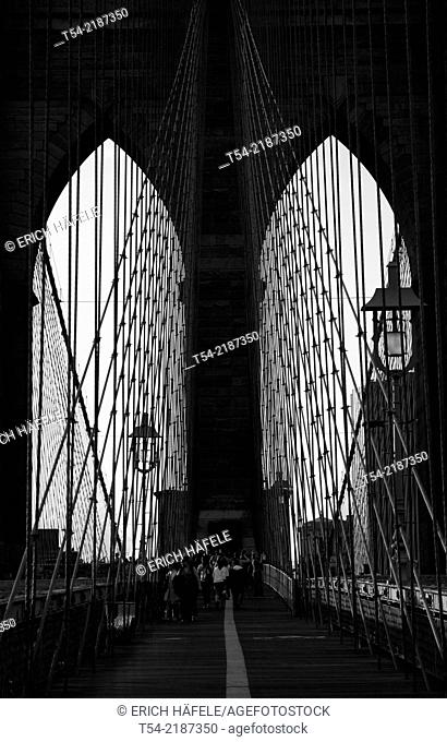 Looking through the neo-gothic gates of the Brooklyn Bridge in New York