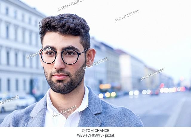 Portrait of bearded young businessman wearing glasses