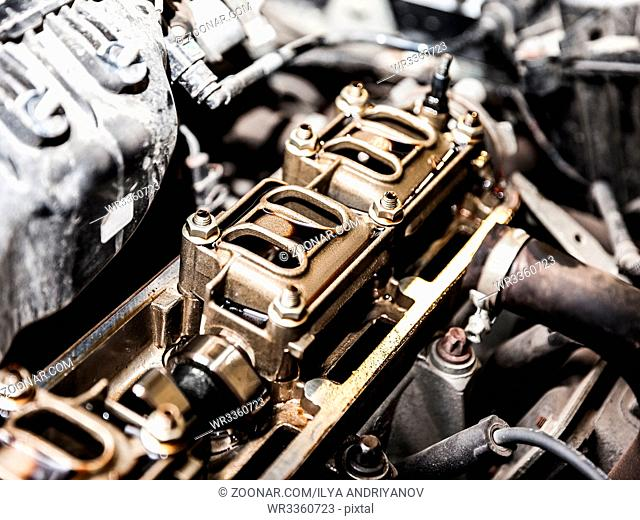 Vehicle motor or auto car engine at automobile repairing service or garage workshop