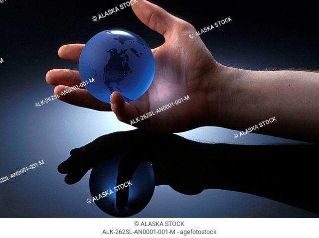 Small Globe of Earth in Palm of Hand Studio Still Life