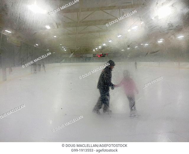 A figure skating coach and his student practice on a foggy rink
