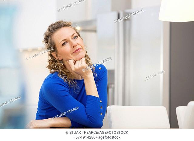 Confident young businesswoman sitting at a table