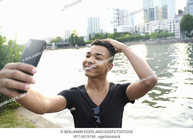 Man taking selfie with phone. Frankfurt am Main, Germany