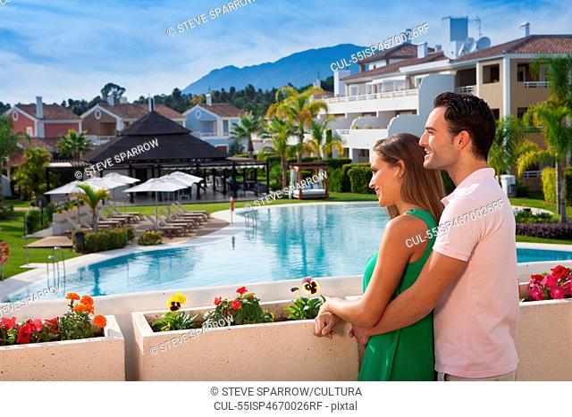 Young couple looking at view at holiday resort