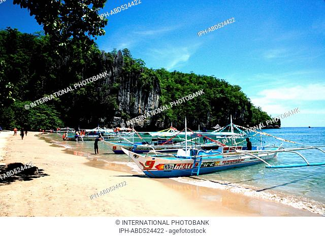 Philippines Palawan Sabang Trip boats at the beach near the subterranean river