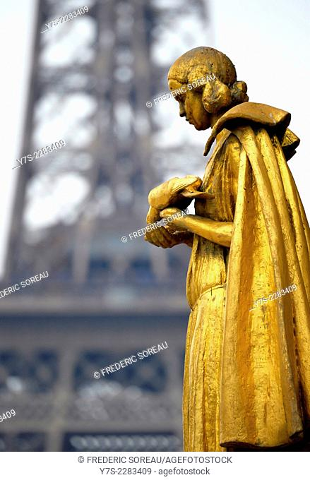 Closed up view of a gilded bronze statues on the central square of the Palais de Chaillot,Paris, France