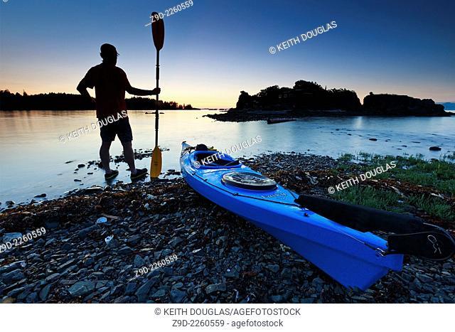 Sea kayaker at sunset, Pipers Lagoon Park, Nanaimo, Vancouver Island, British Columbia
