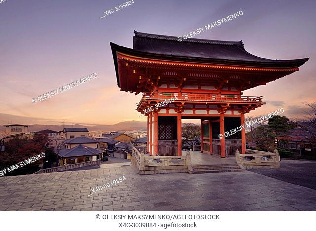 Nio-mon gate of Kiyomizu-dera Buddhist temple in a sunrise morning scenery. Two-storied Romon gate with Kyoto city landscape in the background