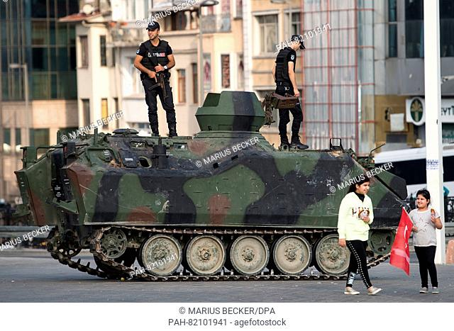 Police officers stand guard on a tank at Taksim Square in Istanbul, Turkey, 17 July 2016. Turkish authorities said they had regained control of the country...