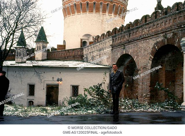 View of a Western man posing in a church courtyard within the Novodevichy Convent complex, in Moscow, Soviet Union, USSR, November, 1973. ()