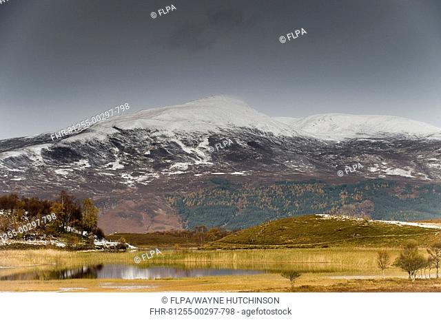 View of loch and snow covered hills, Lochan an Daim, towards Meall Breac, Kinloch Rannoch, Perthshire, Scotland, late autumn