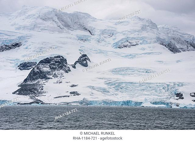 Glacier hanging on the rocks of Coronation Island, South Orkney Islands, Antarctica, Polar Regions