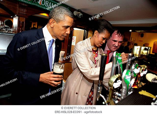 President Barack Obama watches as First Lady Michelle Obama draws a pint at Ollie Hayes Pub in Moneygall Ireland May 23 2011. 5752656612-f7cd06c891-o