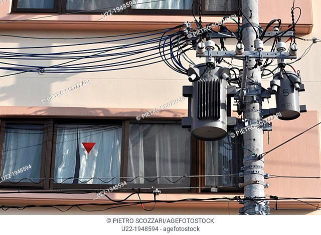Naha, Okinawa, Japan, electric poles too near to apartments