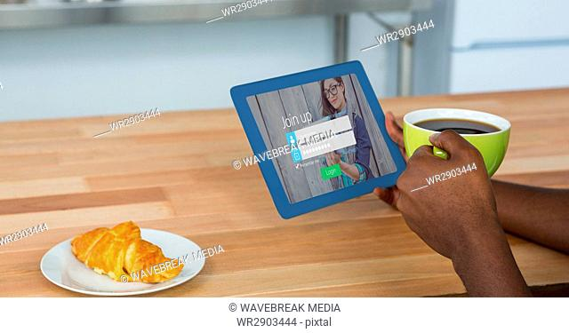 Cropped image of person holding digital tablet with join up page on screen while having coffee