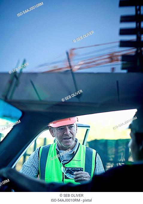 Construction workers talking in car