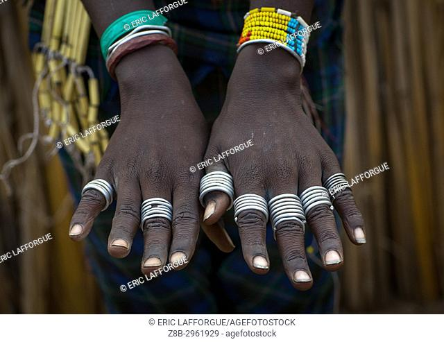 Hands with rings of an Erbore tribe woman, Omo valley, Murale, Ethiopia