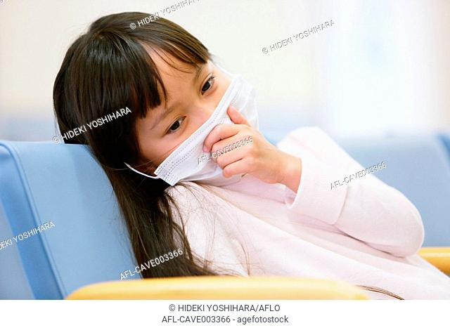 Sick young Japanese girl at the hospital