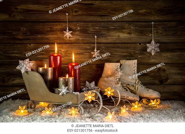Christmas decoration with four burning candles and old vintage objects