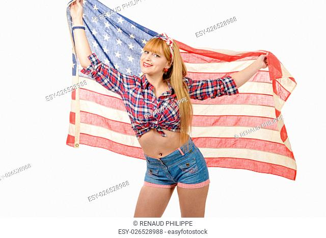 a sexy pin up girl holding an American flag