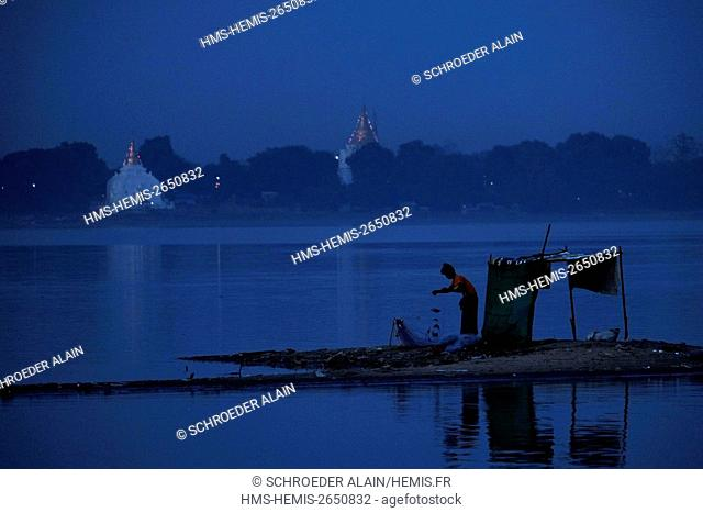 Myanmar, Mandalay, Mandalay Province, next to U Bein Bridge, Lake Thaugthung and fisherman