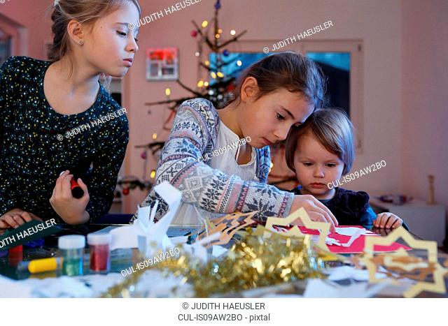 Girls at table doing christmas paper craft