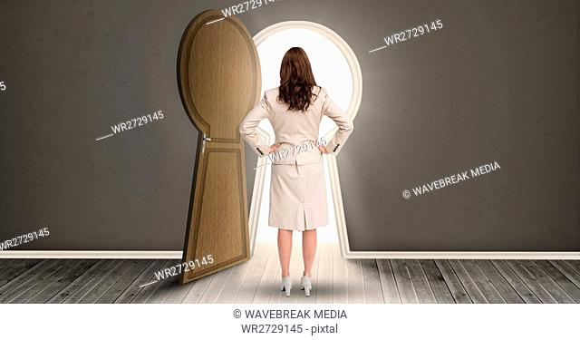 Woman standing against keyhole shaped doorway with light dark grey room