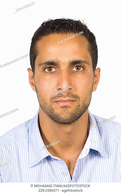 Portrait of a serious young Arabic man