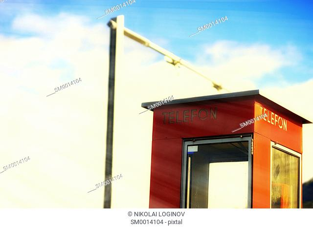 Vertical Norway telephone booth with light leak backdrop hd