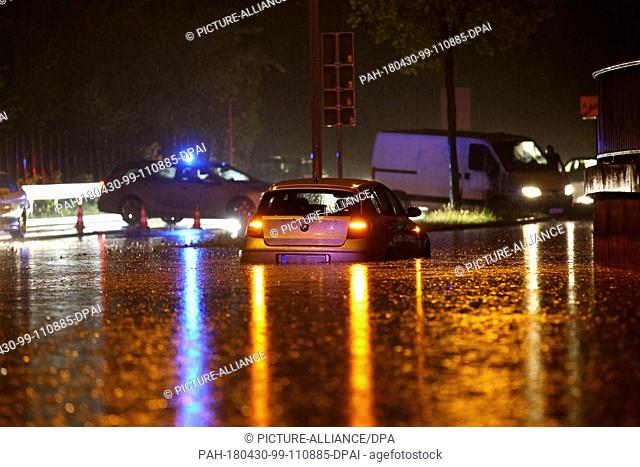 29 April 2018, Germany, Aachen: A flooded street. There were heavy storms in the Eifel and the regions nearby. Policemen report cases of cellars flooding