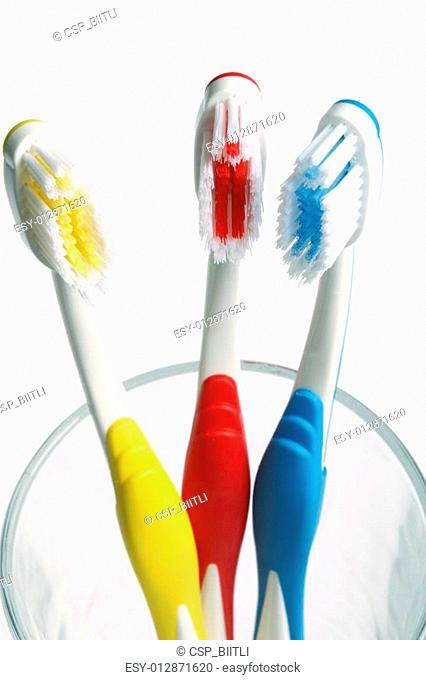 three toothbrushes