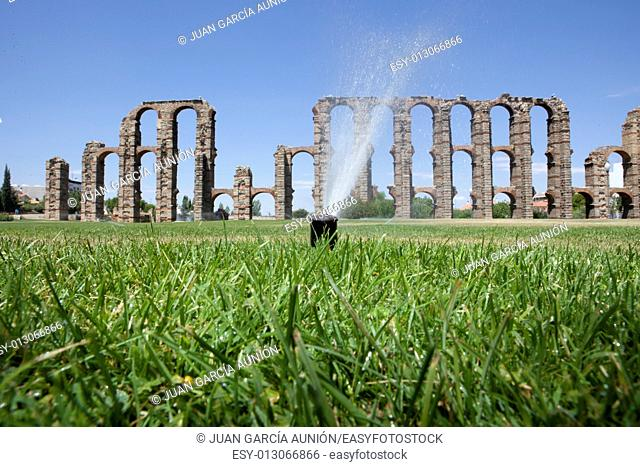 Grass Sprinklers wtih Roman Aqueduct of Merida at the bottom. Extremadura, Spain