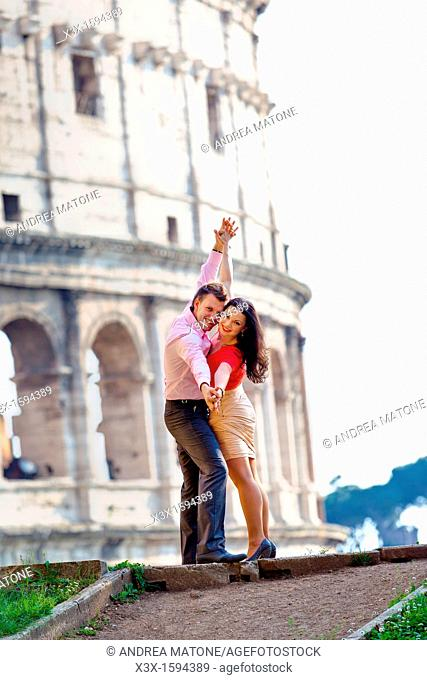 Couple at the Roman Coliseum Rome Italy