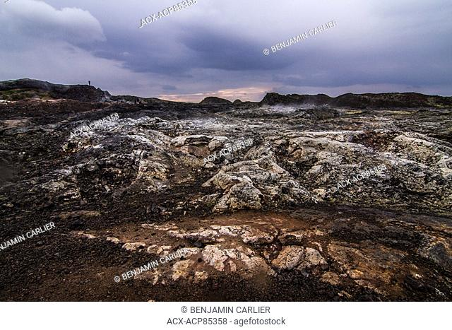 Steam among the cooled lava flow near Krafla in the M-vatn region in Iceland