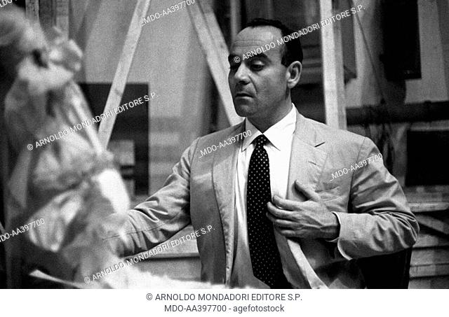 Vittorio Caprioli looking at himself on the mirror. Italian actor, director and screenwriter Vittorio Caprioli solemnly looking at himself on the mirror with...