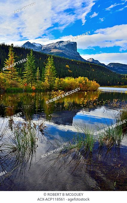 A vertical fall landscape image of Roche Miette mountain standing tall at the entrance to Jasper National Park, in Alberta Canada
