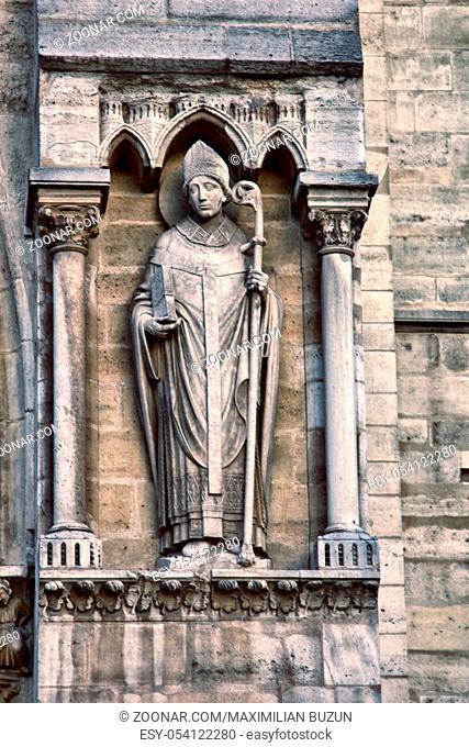 Notre Dame de Paris Cathedral Gothic style. Architectural details, Denise Paris, portal of St. Anne, semi-circular pediment