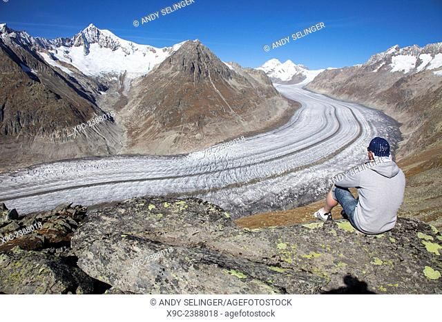A Man Enjoying the View Over Aletsch Glacier, Switzerland