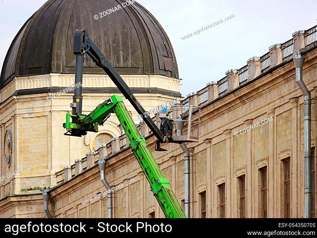 hydraulic lift heavy equipment machine that works near the palace