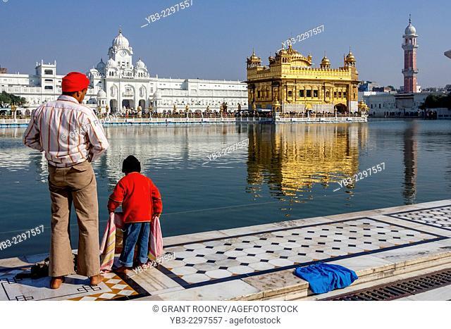 Sikhs Preparing To Bathe In The Sarovar, The Golden Temple of Amritsar, Punjab, India