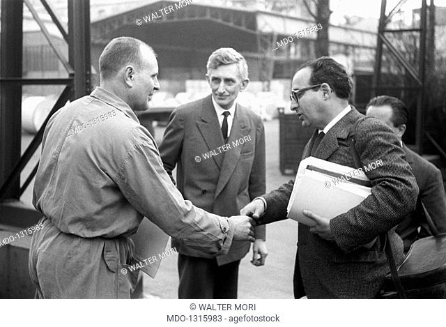 Mario Fani shakes hands with a Pirelli's responsable. Mario Fani, 41 years old, Pirelli's stoker, meet a series of firm responsables in his company
