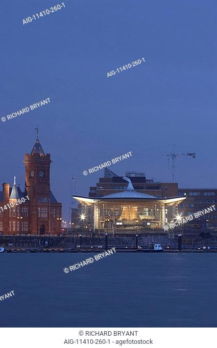 National Assembly for Wales, Cardiff. Exterior at dusk from across the bay. Architect: Richard Rogers Partnership