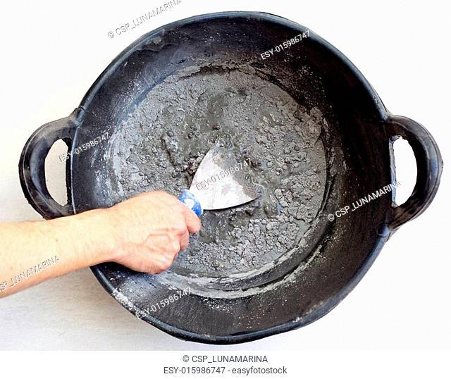 cement portland gray fresh mortar mix with spatula